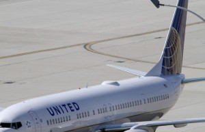 A United Airlines plane with the Continental Airlines logo on its tail, sits at a gate at O'Hare International airport in Chicago in this file photo taken on October 1, 2010. REUTERS/Frank Polich